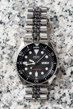 calibre: BANGKOK, THAILAND - FEBRUARY 16, 2016: The SEIKO Divers 200m Automatic SKX007 with 7S26 movement and jubilee bracelet.