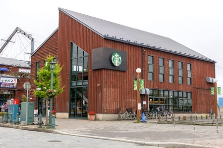 starbucks coffee: HOKKAIDO, JAPAN - JULY 19, 2015: Starbucks store in Kanemori Red Brick Warehouse. Starbucks is the worlds largest coffee house with over 20,000 stores in 61 countries.