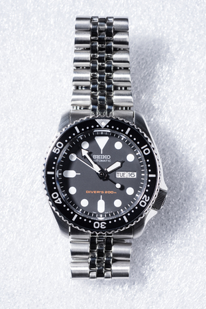 calibre: BANGKOK, THAILAND - FEBRUARY 18, 2016: The SEIKO Divers 200m Automatic SKX007 with 7S26 movement and jubilee bracelet. Editorial