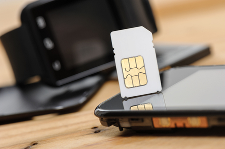 mini size of SIM card with smart phone Stock Photo