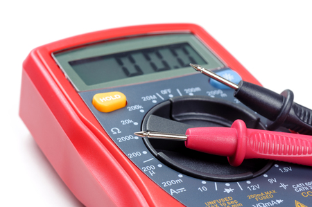 digital multimeter or multitester or Volt-Ohm meter (closeup at test leads), an electronic measuring instrument that combines several measurement functions in one unit. Stock Photo