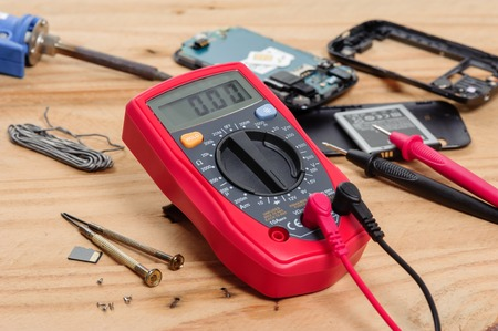 digital multimeter or multitester or Volt-Ohm meter, an electronic measuring instrument that combines several measurement functions in one unit. Stock Photo
