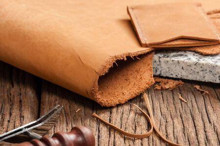 leather working, closeup details of brown nubuck leather