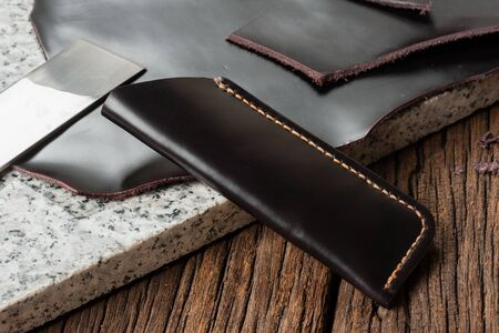 leather working, closeup product from black leather