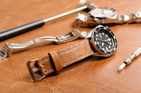 closeup handmade brown leather watch strap, leather product