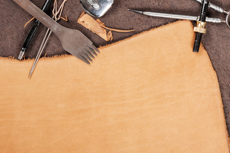 leather working background, blank tan nubuck leather in workshop