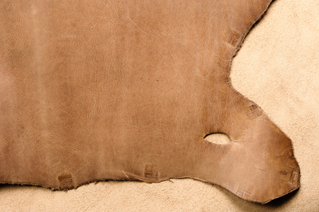chocolatería: raw material background, closeup details of brown leather texture