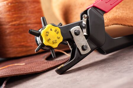 The rotary leather punch for hand stitching leather Stock Photo