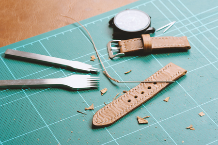 leather working, leather product, closeup brown leather watch band Stock Photo