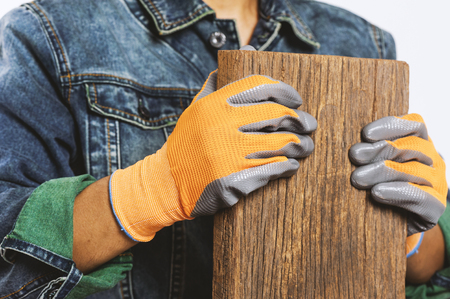 Closeup all purpose gloves with non-slip rubber coated on wokers hand. Stock Photo