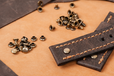 working with metal fittings, material for handicraft leather working and garment. Stock Photo