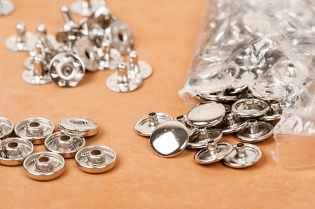 closeup heap of metal fittings, material for handicraft leather working and garment.