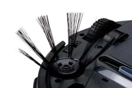 closeup brush under robotic vacuum cleaner Stock Photo