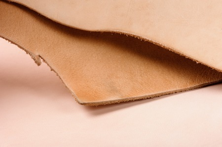 closeup texture of vegetable tanned leather, raw material for leather working