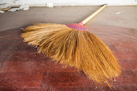 broom handle: closeup the broom with long handle on dusty floor
