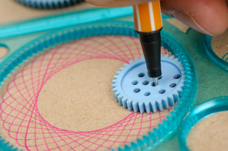 Drawing the spirograph pattern with spirograph kit