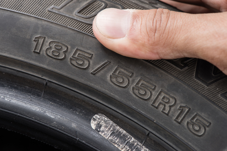sidewall: closeup details of car tire, sidewall information