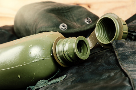 plastic soldier: an empty military water canteen, military water bottle Stock Photo