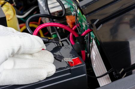Technician replacing the UPS(Uninterruptible Power Supply) battery. Stock Photo