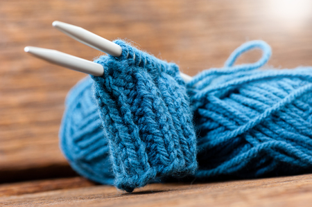 motouz: Blue knitting wool and knitting needles, knitting equipment Reklamní fotografie