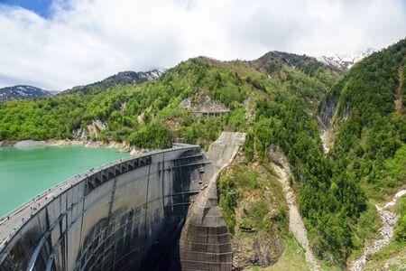 variable: View of Kurobe Dam. The Kurobe Dam or Kuroyon Dam is a variable-radius arch dam on the Kurobe River in Toyama Prefecture, Japan. Stock Photo