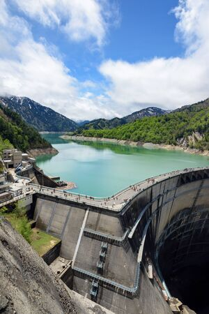 View of Kurobe Dam. The Kurobe Dam or Kuroyon Dam is a variable-radius arch dam on the Kurobe River in Toyama Prefecture, Japan. Stock Photo