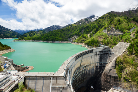 View of Kurobe Dam. The Kurobe Dam or Kuroyon Dam is a variable-radius arch dam on the Kurobe River in Toyama Prefecture, Japan. Stock Photo