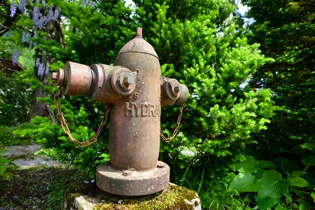 GIFU, JAPAN - MAY 16, 2016: Vintage fire hydrant in Shirakawago. Shirakawago or Shirakawa Village is world heritage village. Editorial