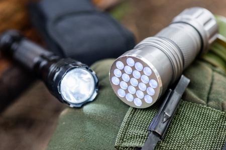 pocket flashlight for Everyday Carry (EDC), shallow depth of field Stock Photo