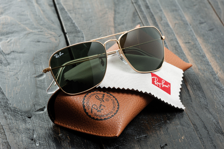 BANGKOK, THAILAND - AUGUST 24, 2016: The Ray-Ban Caravan with gold frame and classic G-15 Lens. Ray-Ban is a brand of sunglasses and eyeglasses founded in 1937 by American company Bausch & Lomb.
