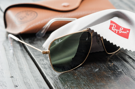 BANGKOK, THAILAND - AUGUST 24, 2016: The Ray-Ban Caravan with gold frame and classic G-15 Lens. Ray-Ban is a brand of sunglasses and eyeglasses founded in 1937 by American company Bausch & Lomb. Editorial