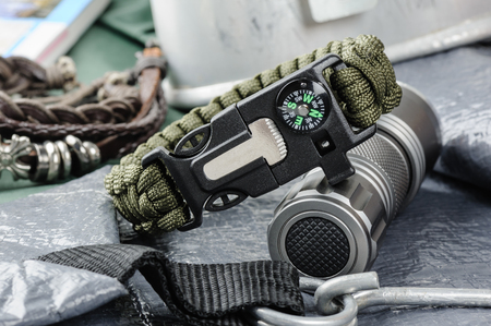 closeup green multifunction paracord survival bracelet for camping