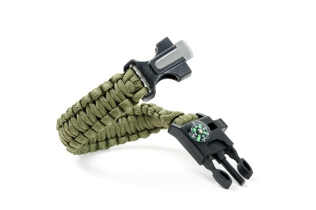 green multifunction paracord survival bracelet over white background Stock Photo