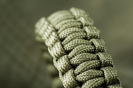 closeup braided green paracord bracelet, handmade paracord bracelet