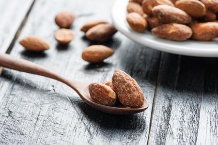 closeup heap of roasted salted almonds, peeled almonds