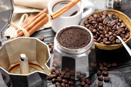 aluminium: closeup detail of coffee ground in moka pot
