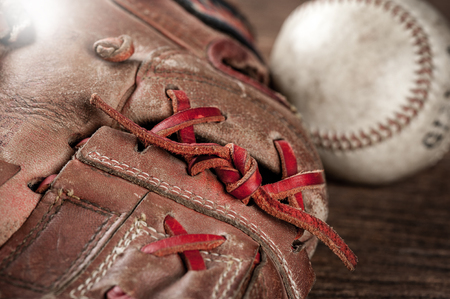 mitt: abstract old vintage baseball glove with baseball (Shallow depth of field)