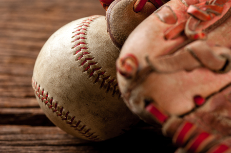 old vintage baseball on wooden background (Shallow depth of field and low light)