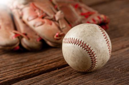 mitt: old vintage baseball on wooden background (Shallow depth of field)