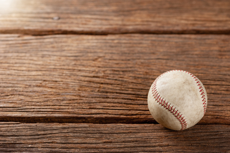 old vintage baseball on wooden background (Shallow depth of field)