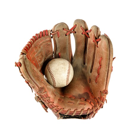 old vintage baseball glove with the baseball held in the palm isolated over white background