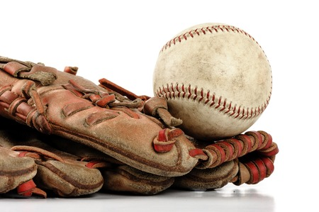 old vintage baseball glove with the baseball isolated over white background Stock Photo