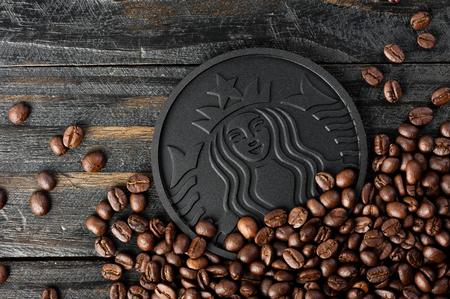 BANGKOK, THAILAND - OCTOBER 21, 2016: Closeup black Starbucks Coaster made from Recycled Starbucks Coffee Grounds.