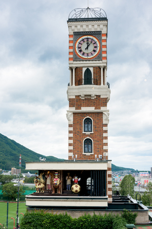 HOKKAIDO, JAPAN - JULY 22, 2015: Clock tower in the Rose Garden in Shiroi Kohibito Park. Shiroi Kohibito Park is a fantastic park inside Ishiya Chocolate Factory. Editorial
