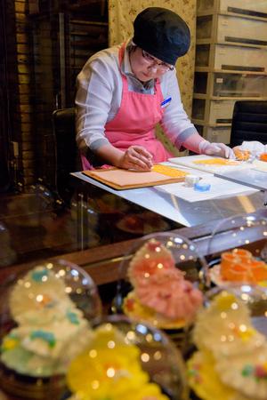 HOKKAIDO, JAPAN - JULY 22, 2015: An unidentified artist making the beautiful sugarcrafts at Sugar Craft Studio inside Ishiya Chocolate Factory in Sapporo, Hokkaido, Japan. Editorial