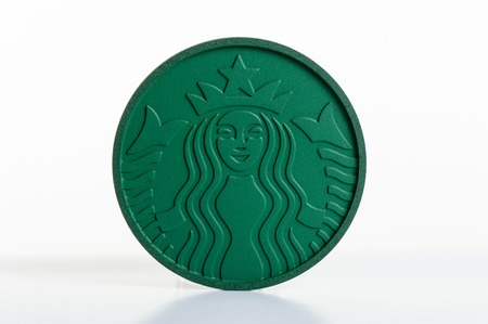 illustrative editorial: BANGKOK, THAILAND - OCTOBER 21, 2016: Starbucks Coaster made from Recycled Starbucks Coffee Grounds. Editorial