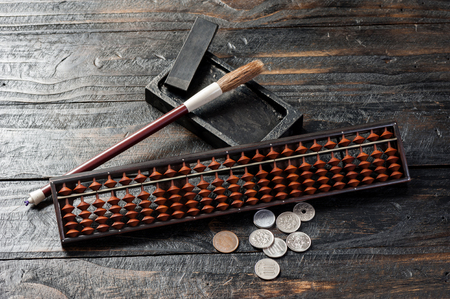 calculator chinese: japanese style of bamboo abacus on the desk Stock Photo