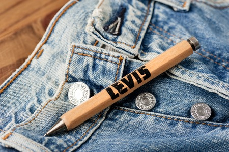levi: BANGKOK, THAILAND - NOVEMBER 01, 2016: An old wooden souvenir pen from LEVIs. LEVIS is a brand name of Levi Strauss and Co, founded in 1853. Editorial