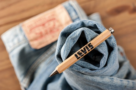 levis: BANGKOK, THAILAND - NOVEMBER 01, 2016: An old wooden souvenir pen from LEVIs. LEVIS is a brand name of Levi Strauss and Co, founded in 1853. Editorial