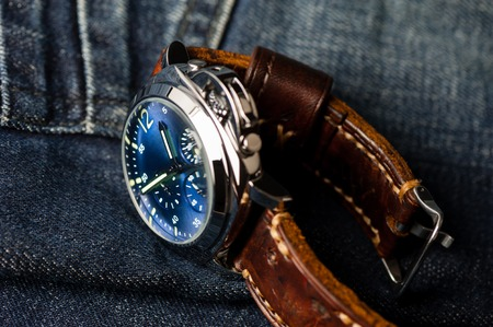 luxury fashion watch with blue dial and brown leather watch band (ammo style watch strap)